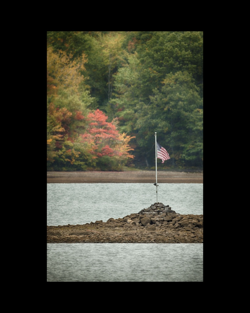 The Flag at Glass Lake. Nikon Df camera, MC MTO-1100 telephoto lens. Photo by Chuck Miller.